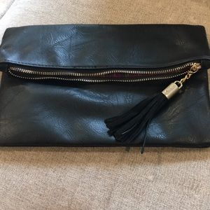 New never used . Black fold over clutch